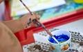 Giochi di pittura in spiaggia a Lignano